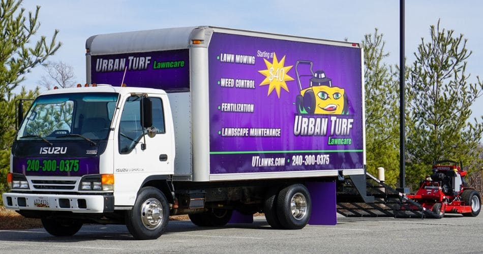 Urban Turf's box truck and commercial lawn mower.