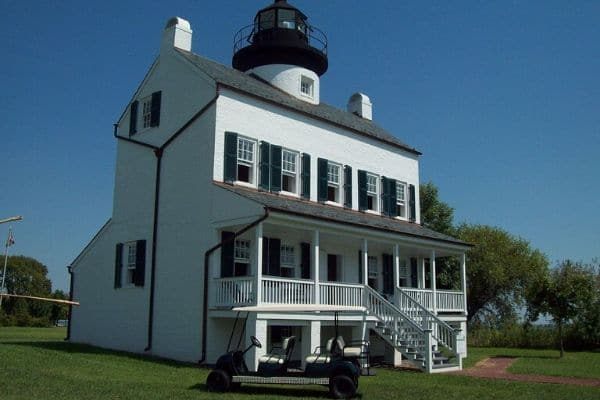 White Porch House with a Lighthouse on top