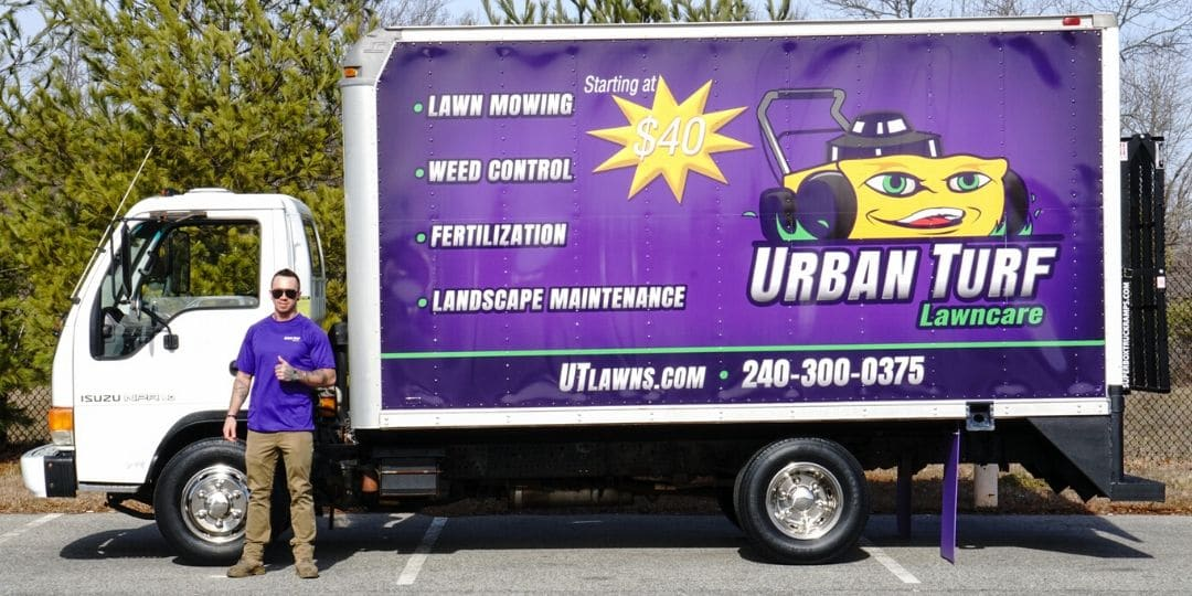 Gary with Urban Turf standing in from of Urban Turf's box truck giving the 'thumbs up' gesture.